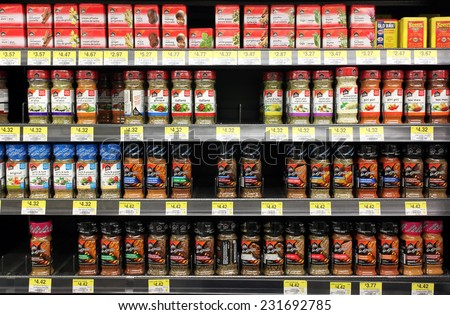 TORONTO, CANADA - OCTOBER 31, 2014: Various spices and seasoning powders on shelves in a supermarket. McCormick is one of the main  manufactures spices, herbs, and flavorings in the world. - stock photo