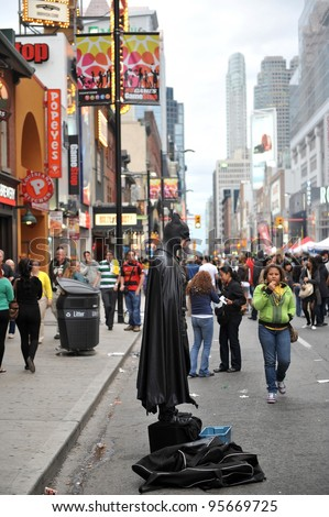TORONTO, CANADA - SEPT 5:  The street performer and Youtube celebrity known as Toronto Batman performs on Yonge Street which was closed down for Brazilian Day on Sept 5, 2011 in Toronto, Ontario, Canada.