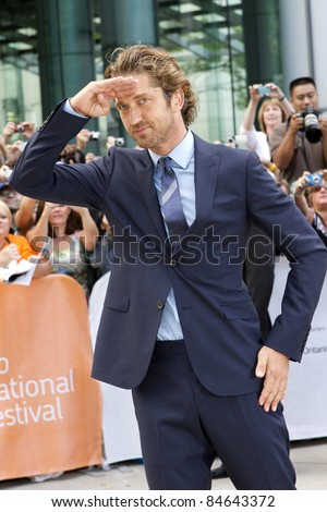 "TORONTO, CANADA - SEPTEMBER 11: Actor Gerard Butler arrives at the gala screening of the movie ""Machine Gun Preacher"" at the 2011 Toronto International Film Festival on Sept. 11, 2011 in Toronto, Canada. - stock photo"
