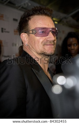 "TORONTO, CANADA - SEPTEMBER 8, 2011: U2 lead singer, Bono, arrives at the gala screening of the documentary ""From The Sky Down"" at the opening of the 2011 Toronto International Film Festival on Sept. 8, 2011. - stock photo"
