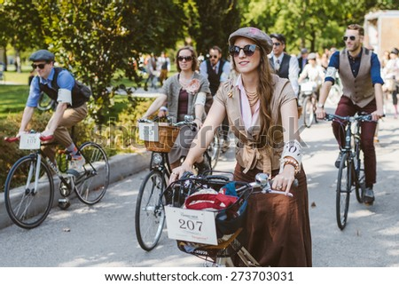 Toronto, Canada - September 20, 2014: Unidentified participants of Tweed Ride Toronto in vintage style clothes riding on their bicycles. This event is dedicated to the style of old England. - stock photo