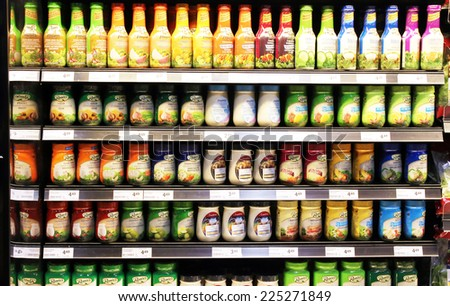 TORONTO, CANADA - SEPTEMBER 13, 2014: Variety of sauces and dressings on shelves in a supermarket. Europe and North America are the leading consumers of sauces, dressings and condiments in the world. - stock photo