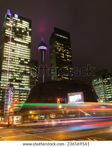 TORONTO, CANADA - 9TH DECEMBER 2014: Part of downtown Toronto, showing the CN Tower, traffic, office buildings and the Roy Thomson Hall - stock photo