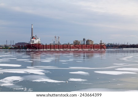 TORONTO, CANADA - 11TH JANUARY 2015: A cargo ship docked in Toronto in the winter showing the frozen lake ontario. - stock photo
