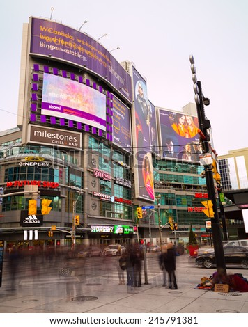 TORONTO, CANADA - 17TH JANUARY 2015: A view of part of Yonge and Dundas Square in Toronto during the day, showing the blur of people