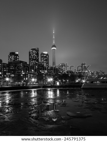 TORONTO, CANADA - 18TH JANUARY 2015: The CN Tower and buildings in the winter, showing Ice in the foreground - stock photo