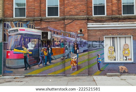 TORONTO, CANADA - 7TH OCTOBER 2014: Wall art along Queen Street West in Toronto - stock photo