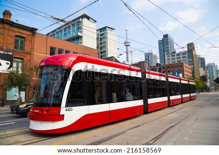 TORONTO, CANADA - 9TH SEPTEMBER 2014: A view of the new Toronto Street Cars during the day. Passengers can be seen on the vehicle - stock photo