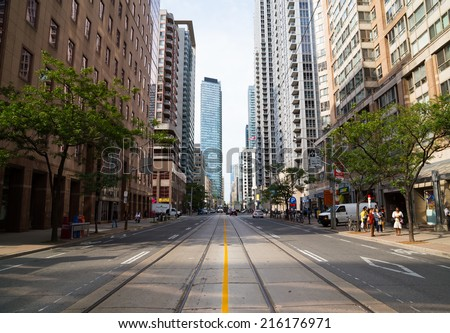 TORONTO, CANADA - 9TH SEPTEMBER 2014: View up Bay Street in downtown Toronto during the day - stock photo