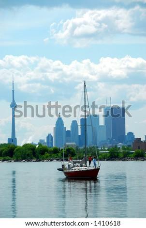 Toronto city skyline with a sailboat - stock photo
