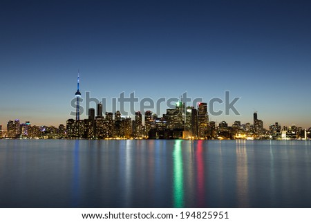 Toronto Cityscape at Dusk with reflections in the water - stock photo