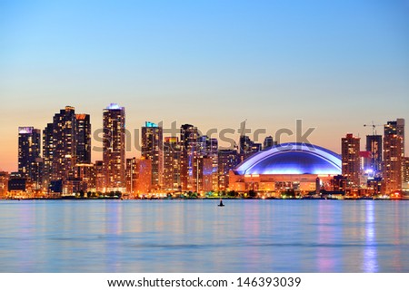 Toronto cityscape panorama at dusk over lake with colorful light. - stock photo