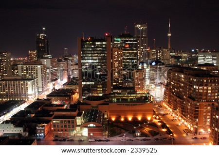 Toronto CN tower and streets at night long exposure - stock photo