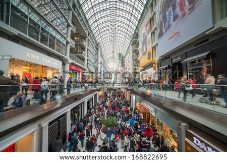 TORONTO - DECEMBER 26: Shoppers visit the mall in Toronto, Canada on  Boxing Day, December 26, 2013. - stock photo