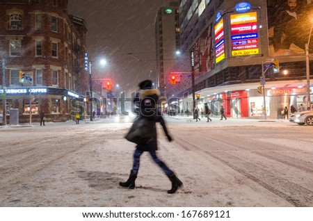 TORONTO-DECEMBER 14: Toronto is Canada's largest city and sixth largest government, and home to a population of about 2.8 million people. City under snowstorm. Seen in Toronto, Canada on Dec 14, 2013 - stock photo