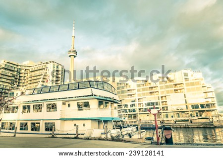 Toronto downtown and skyline from the harbour waterfront wit traditional sailing boat - World famous city of Canada in the north part of american continent - stock photo