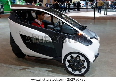 TORONTO-FEBRUARY 12: at the 2015 Canadian International Auto Show demonstration of Toyota i-Road, the ultimate fuel-efficient and fun-to-drive small urban vehicle on February 12, 2015 in Toronto  - stock photo