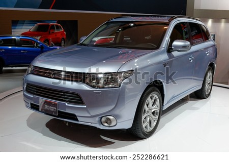 TORONTO-FEBRUARY 12: at the 2015 Canadian International Auto Show  Mitsubishi Outlander PHEV is a 200bhp hybrid SUV capable of 0-60mph in 10.0sec  on February 12, 2015 in Toronto .  - stock photo