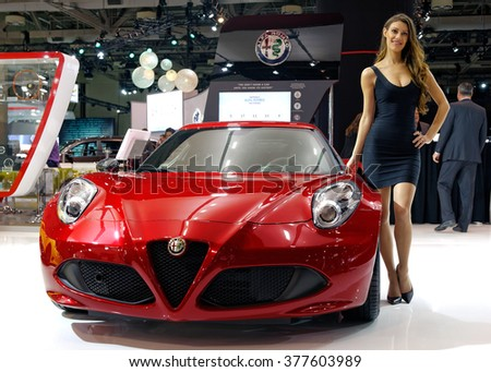 TORONTO-FEBRUARY 12: at the 2016 Canadian International AutoShow, Alfa Romeo 4C Coupe has carbon-fibre body, 1.8L turbocharged engine with 237hp and acceleration 0 to100 km/h in 4.1 seconds - stock photo