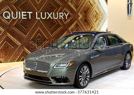 TORONTO-FEBRUARY 12: at the 2016 Canadian International AutoShow all new 2017 Lincoln Continental comes with twin turbocharged 3.0-litre V6 engine that produces a 400 horsepower - stock photo