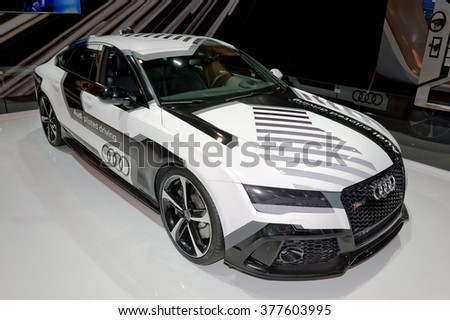 TORONTO-FEBRUARY 12: at the 2016 Canadian International AutoShow, Audi RS7 piloted vehicle raced around the Hockenheim Grand Prix track without a driver while reaching speeds up to 240 km/h. - stock photo