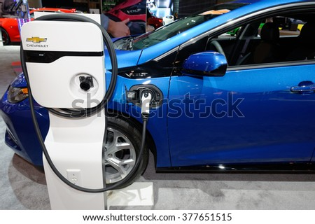TORONTO-FEBRUARY 12: at the 2016 Canadian International AutoShow.Charging Station and Chevrolet Volt - stock photo