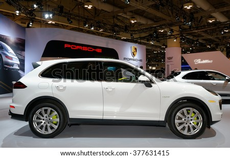 TORONTO-FEBRUARY 12: at the 2016 Canadian International AutoShow. The Porsche Cayenne S E-Hybrid is trendsetter with parallel plug-in hybrid that boasts plenty of agility, luxury and technology - stock photo