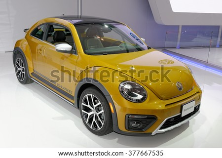TORONTO-FEBRUARY 12: at the 2016 Canadian International AutoShow,2016 Volkswagen Beetle Dune raised ride height of 10 mm and a body track that is 14 mm wider give it a more rugged stance. - stock photo