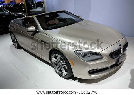 TORONTO-FEBRUARY 17: BMW 650i convertible at the 2011 Canadian International Auto Show on February 17, 2011 in Toronto - stock photo