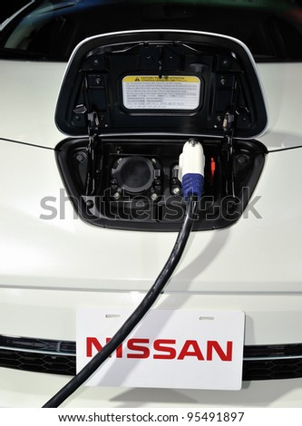 TORONTO-FEBRUARY 16: Charging Nissan MIEV at the 2012 Canadian International Auto Show on February 16, 2012 in Toronto