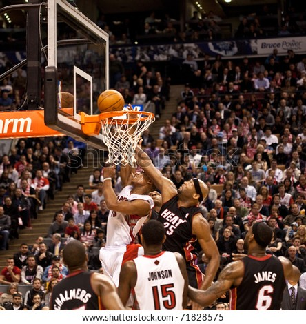 TORONTO - FEBRUARY 16: DeMar DeRozan No. 10 participates in an NBA basketball game at the Air Canada Centre on February 16, 2011 in Toronto, Canada.  The Miami Heat beat the Toronto Raptors 103-95. - stock photo