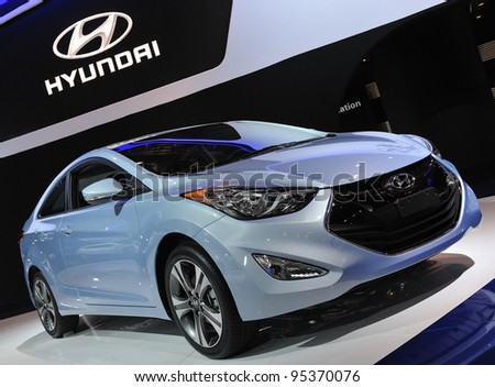 TORONTO-FEBRUARY 16: Hyundai Elantra,The North American Car of the Year, on display at the 2012 Canadian International Auto Show on February 16, 2012 in Toronto, Canada. - stock photo
