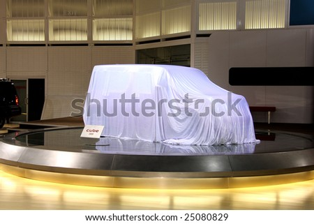 TORONTO, FEBRUARY 11: Nissan Cube waiting to be unveiled at the Canadian International AutoShow 2009.  More than 1000 cars are trucks are on display at this show - stock photo