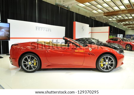 TORONTO-FEBRUARY 22: Range of Ferrari cars on display during the 40th International Auto Show on February 22, 2013 in Toronto, Canada. - stock photo