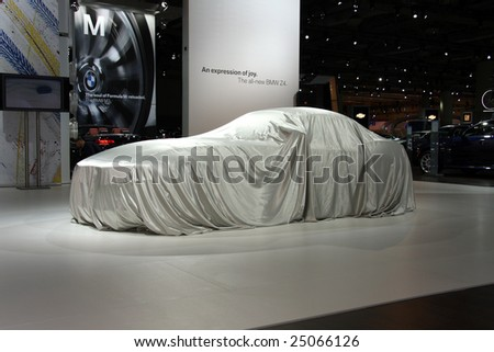 TORONTO, FEBRUARY 11: the new BMW Z4 waiting to be unveiled at the Canadian International AutoShow 2009, one of 11 Canadian car premieres at CIAS2009 - stock photo