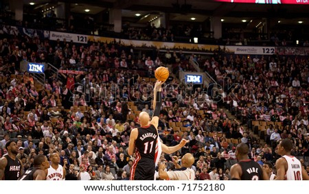 TORONTO - FEBRUARY 16: Tipoff at an NBA basketball game at the Air Canada Centre on February 16, 2011 in Toronto, Canada.  The Miami Heat beat the Toronto Raptors 103-95. - stock photo