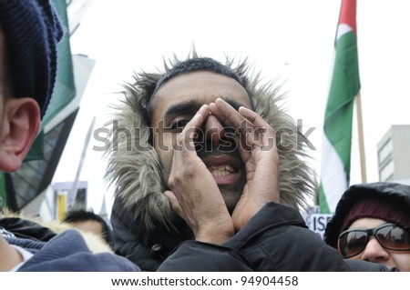 TORONTO - JANUARY 10:  A male Arab protestor shouting slogans  during a rally to condemn the Israel occupation on Gaza on January 10 2009 in Toronto, Canada.
