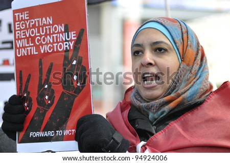 TORONTO - JANUARY 21:   An Egyptian woman participating in a rally at Yonge and Dundas square during the global day of support for the Egyptian revolution on January 21 2012 in Toronto, Canada.