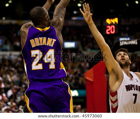 TORONTO - JANUARY 24: Kobe Bryant (L) participates in an NBA basketball game at the Air Canada Centre on January 24, 2010 in Toronto, Canada.  The Toronto Raptors beat the Los Angeles Lakers 106-105. - stock photo