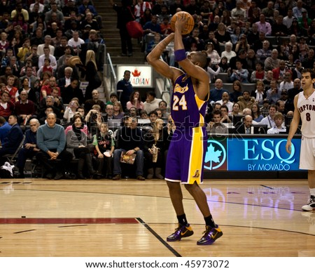 TORONTO - JANUARY 24: Kobe Bryant participates in an NBA basketball game at the Air Canada Centre on January 24, 2010 in Toronto, Canada.  The Toronto Raptors beat the Los Angeles Lakers 106-105. - stock photo