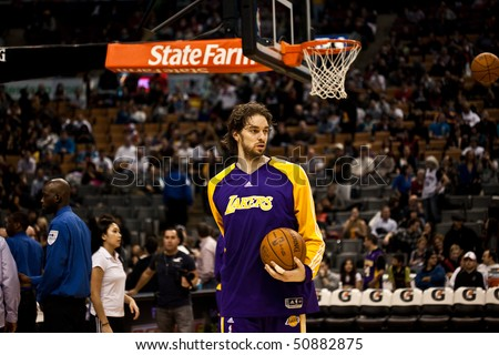 TORONTO - JANUARY 24: Pao Gasol #16 participates in an NBA basketball game at the Air Canada Centre on January 24, 2010 in Toronto, Canada.  The Toronto Raptors beat the Los Angeles Lakers 106-105. - stock photo