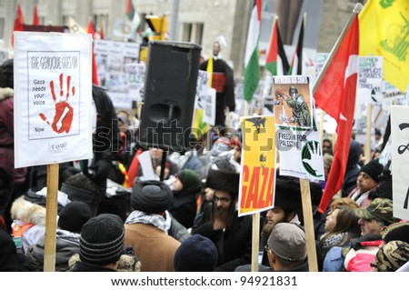 TORONTO - JANUARY 10: Sign, Placards and messages during a rally to condemn the Israel occupation on Gaza on January 10 2009 in Toronto, Canada. - stock photo