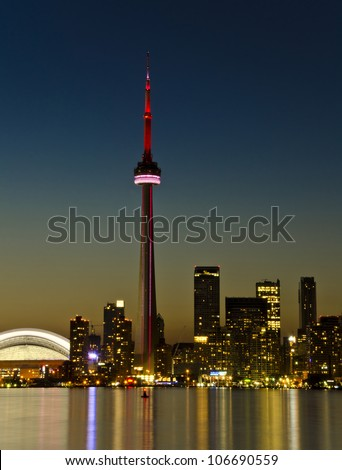 TORONTO - JULY 2: CN Tower at Night. One of the highest structures in the world and a tourist landmark as shown on July 2, 2012 in Toronto - stock photo