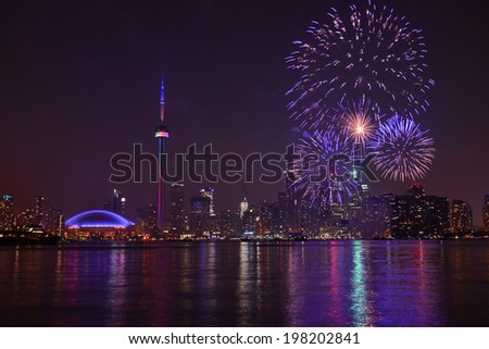TORONTO - JULY 1: Fireworks in Toronto on july 1,2013, celebrating Canada Day which on July 1, 1867, united three colonies into a single country called Canada with enactment of the Constitution Act - stock photo