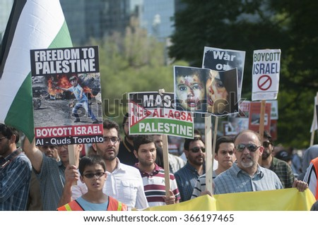 TORONTO-JULY 11: Muslim people of all ages marching in a Ant-Israel rally to mark the Al-Quds day on July 11, 2015 in Toronto,Canada.