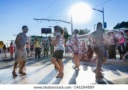 TORONTO-JULY 14: People dancing and celebrating during the ninth edition of Salsa on St Clair Latin Festival. As seen on July 14, 2013 in Toronto, Canada - stock photo