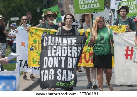 TORONTO - JULY 5 :  People urging climate leaders not to by tar sand during the Jobs,Justice and Climate rally on July  5, 2015 in Toronto, Canada.