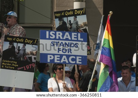 TORONTO-JULY 11: Pro-Israel supporters yelling and waiving signs  to oppose the the Al-Quds day rally on July 11, 2015 in Toronto,Canada. - stock photo