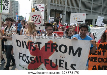 TORONTO - JULY 5 :  Protesters chanting slogans during the Jobs,Justice and Climate rally on July  5, 2015 in Toronto, Canada.
