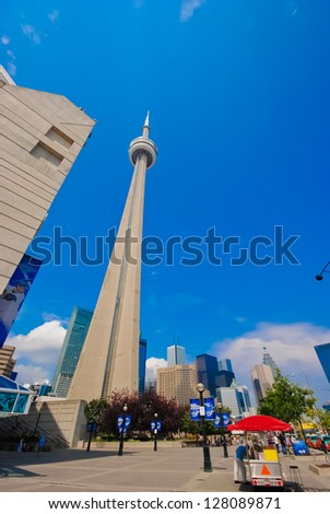 TORONTO - JULY 29: Sky colors over CN Tower on a summer day, July 29, 2011 in Toronto. CN tower is the tallest free-standing structure in the World - stock photo